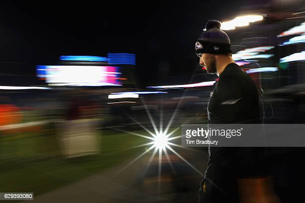 Joe Flacco of the Baltimore Ravens walks onto the field before the game against the New England Patriots at Gillette Stadium on December 12 2016 in...