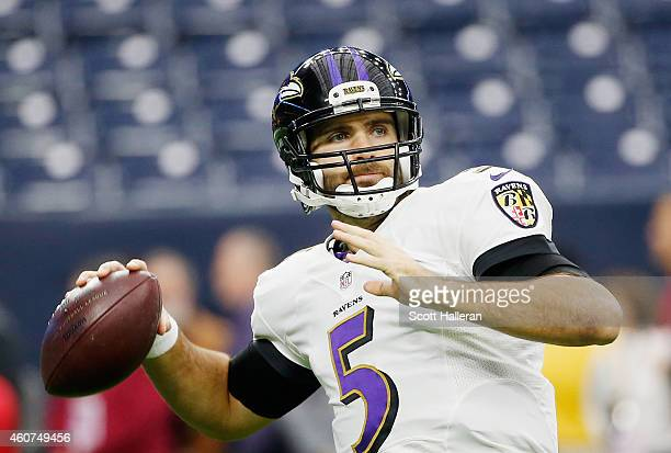 Joe Flacco of the Baltimore Ravens works out on the field before the start of the game against the Houston Texans at NRG Stadium on December 21 2014...