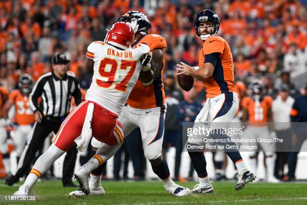 Joe Flacco of the Denver Broncos drops back against the Kansas City Chiefs during the first quarter on Thursday, October 17, 2019.
