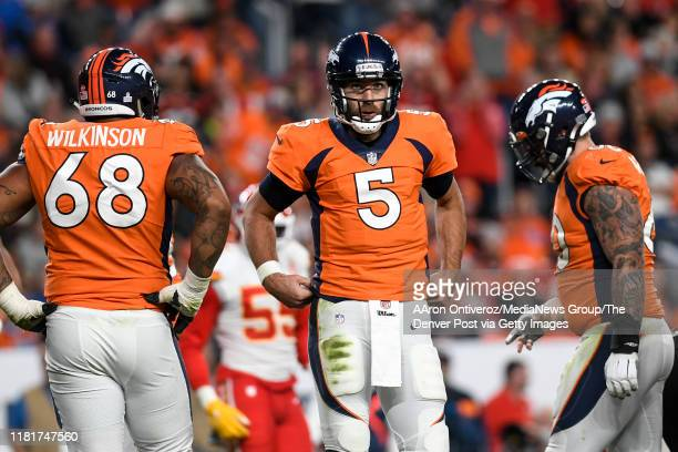 Joe Flacco of the Denver Broncos reacts after fumbling the ball upon being hit by Frank Clark of the Kansas City during the third quarter on...