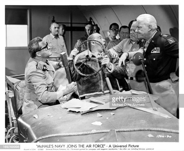 Joe Flynn and Tim Conway try desperately to explain to Willis Bouchey and Tom Tully as to what they're doing in a jeep in a scene from the film...