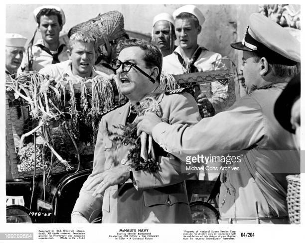 Joe Flynn has his glasses knocked off carrot carrying Tim Conway in a scene from the film 'McHale's Navy', 1964.