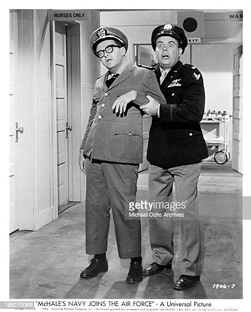 Joe Flynn is aided by a frantic Tim Conway in a scene from the film 'McHale's Navy Joins The Air Force', 1965.