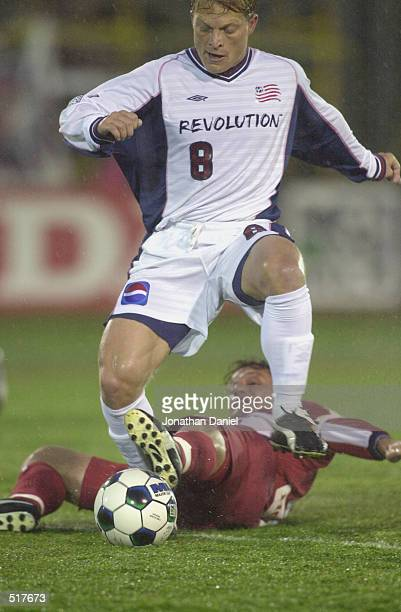 Joe Franchino of the New England Revolution dribbles over the defense of the Chicago Fire during the MLS match at Cardinal Stadium in Naperville,...