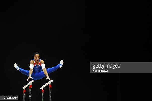Joe Fraser of Great Britain competes in Parallel Bars in the Men's Team Gymnastics Final during the Gymnastics on Day Ten of the European...