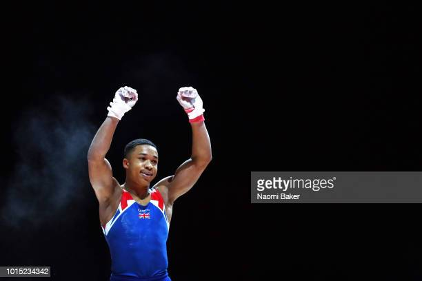 Joe Fraser of Great Britain reacts after competing in Horizontal Bar in the Men' Team Gymnastics Final during the Gymnastics on Day Ten of the...