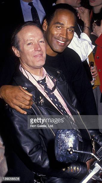 Joe Frazier and OJ Simpson attend the grand opening of the HarleyDavidson Cafe on October 19 1993 in New York City
