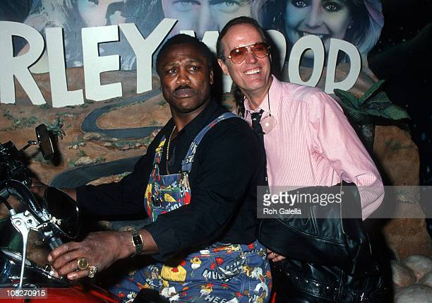 Joe Frazier and Peter Fonda during Grand Opening of The Harley Davidson Cafe at Harley Davidson Cafe in New York City, New York, United States.