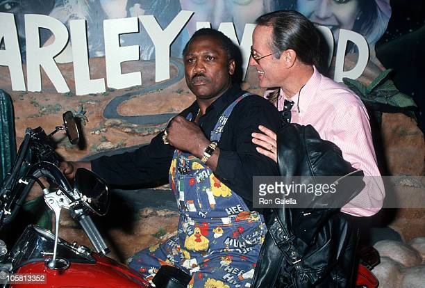 Joe Frazier and Peter Fonda during Grand Opening of The Harley Davidson Cafe at Harley Davidson Cafe in New York City New York United States