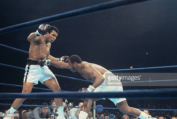 Joe Frazier crouch's and lands a right to the stomach of Muhammad Ali in bout here January 28 Ali won unanimous decision in the 12rounder Both...