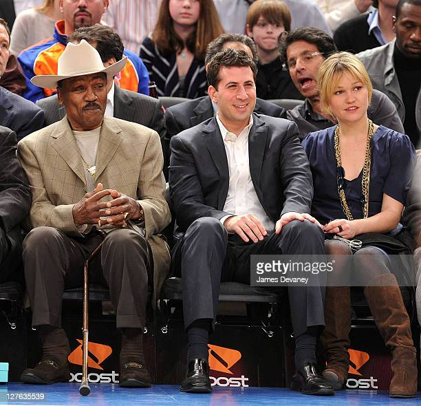 Joe Frazier guest and Julia Stiles attend the Utah Jazz vs New York Knicks game at Madison Square Garden on March 7 2011 in New York City