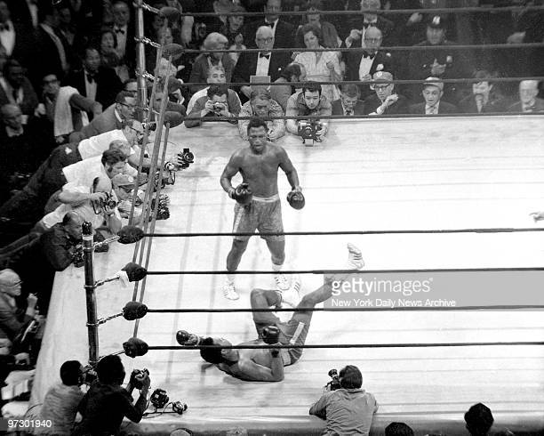 Joe Frazier knocks down Muhammad Ali in the 15th round at Madison Square Garden.
