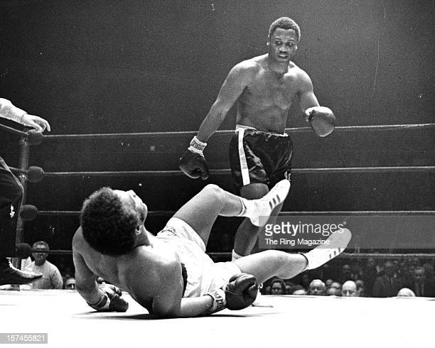 Joe Frazier looks on as he knocks out Jimmy Ellis at the Madison Square Garden on February 161970 in New York New York Joe Frazier won the vacant WBC...