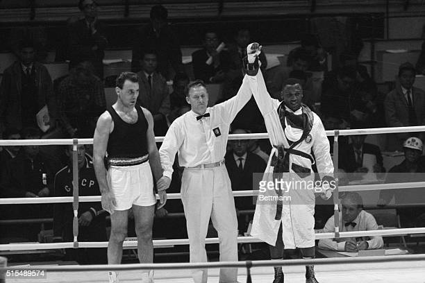Joe Frazier of Philadelphia after he won the Olympic heavyweight boxing match against Germany's Hans Huber October 23 Frazier won the bout by a...
