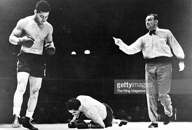 Joe Frazier stands over Max Schmeling after knocking him out during the fight at Yankee Stadium in BronxNew York Joe Louis won by a KO 1