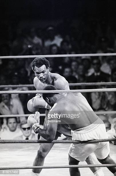 Joe Frazier's knees buckle after George Foreman lands a punch during the second round of their boxing match in Kingston, Jamaica. Foreman wins the...