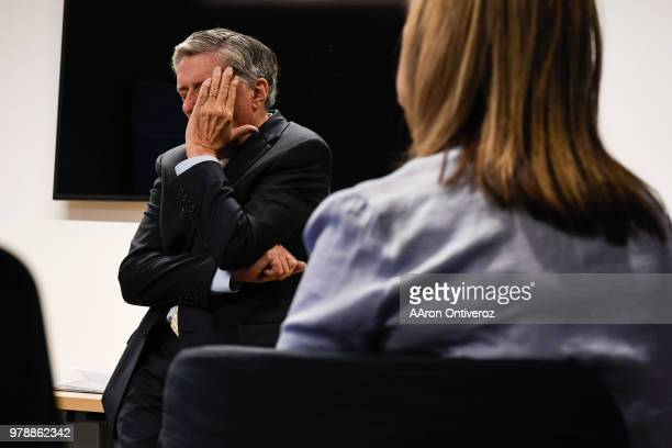Joe Fuchs chairman of Digital First Media rubs his face as he fields questions from Denver Post editorial employees during an open question and...