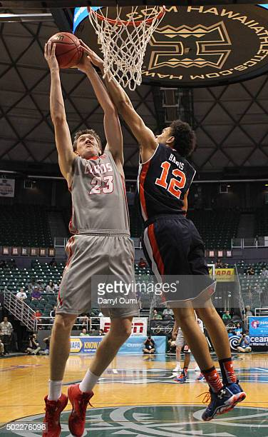 Joe Furstinger of the New Mexico Lobos shoots over Tyler Harris of the Auburn Tigers at the Stan Sheriff Center during the Diamond Head Classic on...