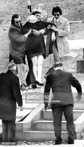 Joe Gallo's mother is aided after fainting outside Guido Funeral home at the Funeral of her son
