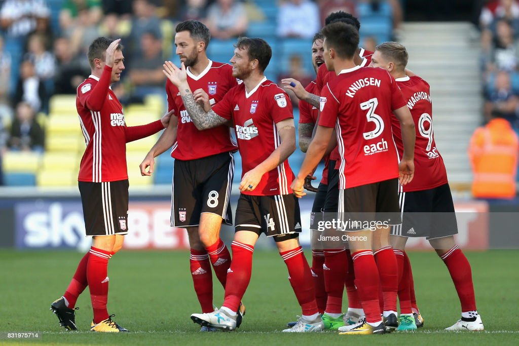 Joe Garner of Ipswich celebrates scoring his sides first goal with his Ipswich team mates during the Sky Bet Championship match between Millwall and Ipswich Town at The Den on August 15, 2017 in London, England.