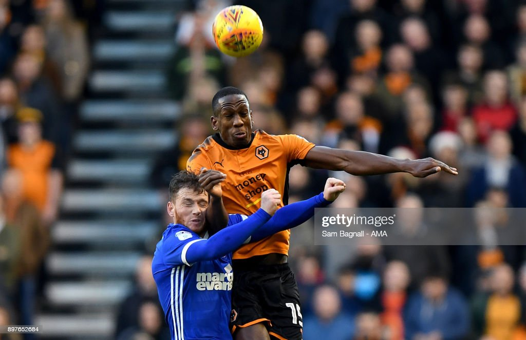 Joe Garner of Ipswich Town and Willy Boly of Wolverhampton Wanderers during the Sky Bet Championship match between Wolverhampton and Ipswich Town at Molineux on December 23, 2017 in Wolverhampton, England.