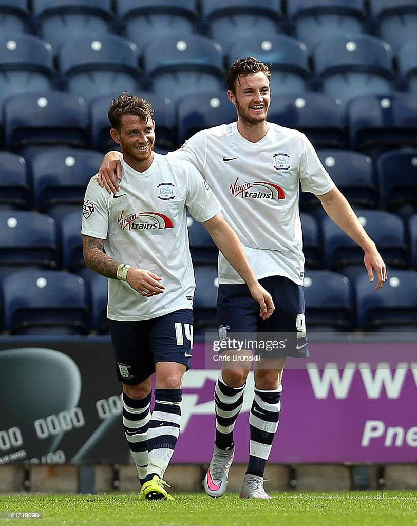 Joe Garner (L) of Preston North End is congratulated by team-mate Will Keane after scoring the opening goal during the pre season friendly match between Preston North End and Hearts at Deepdale on July 18, 2015 in Preston, England.