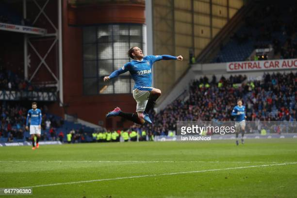 Joe Garner of Rangers celebrates scoring his team's sixth goal during the Scottish Cup Quarter final match between Rangers and Hamilton Academical at...