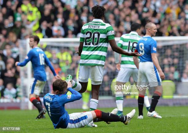 Joe Garner of Rangers holds the boot of Dedryck Boyata of Celtic during the Ladbrokes Scottish Premiership match between Rangers and Celtic at Ibrox...