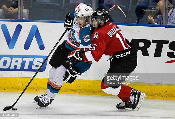 Joe Gatenby of the Kelowna Rockets and Nikolas Brouillard battle for the puck during Game One of the 2015 Memorial Cup at the Pepsi Coliseum on May...