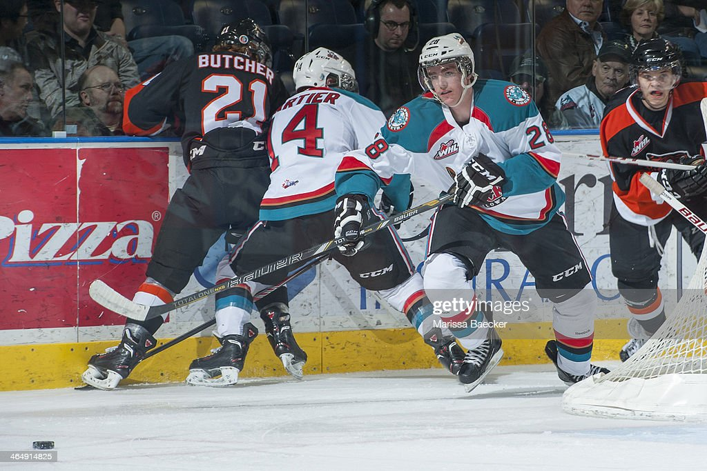 Joe Gatenby #28 of the Kelowna Rockets skates behind the net against the Medicine Hat Tigers on January 24, 2014 at Prospera Place in Kelowna, British Columbia, Canada.