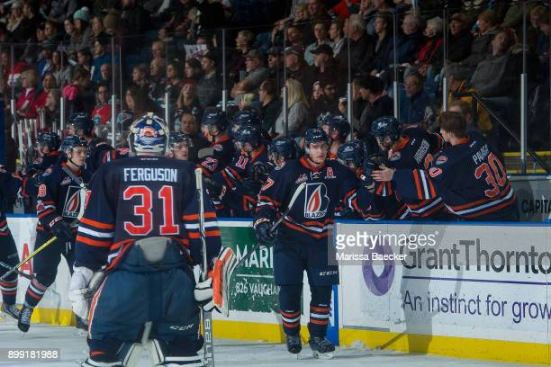 Joe Gatenby skates past the bench toward Dylan Ferguson of the Kamloops Blazers after scoring the third period tying goal at 1842 against the Kelowna...
