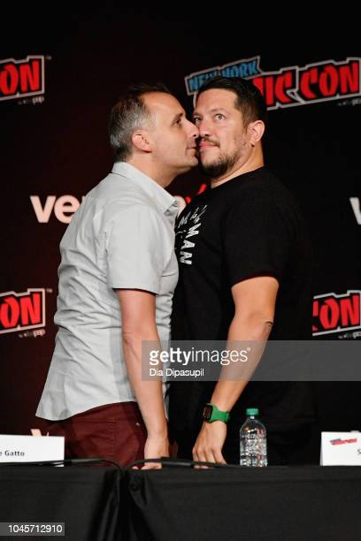 Joe Gatto and Sal Vulcano share a moment onstage at the Four Jokers Seven Seasons One Panel TruTV's Impractical Jokers Return to NYCC Panel during...