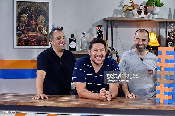 Joe Gatto James Murr Murray and Sal Vulcano of TruTV's Impractical Jokers play FanJenga with Fandango hosts Tiffany Smith and Kristian Harloff at the...