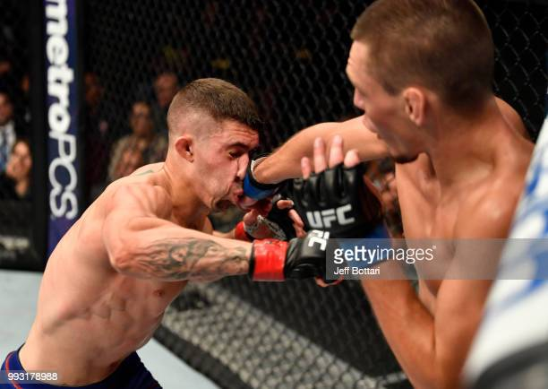 Joe Giannetti punches Michael Trizano in their lightweight bout during The Ultimate Fighter Finale event inside The Pearl concert theater at Palms...