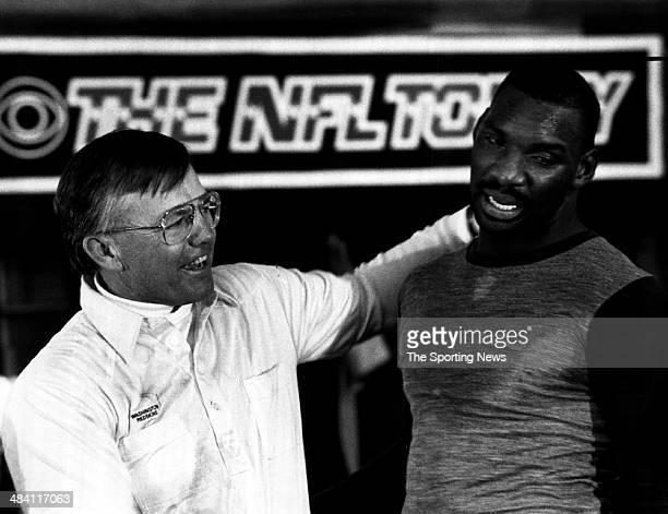 Joe Gibbs of the Washington Redskins congratulates Doug Williams circa 1980s
