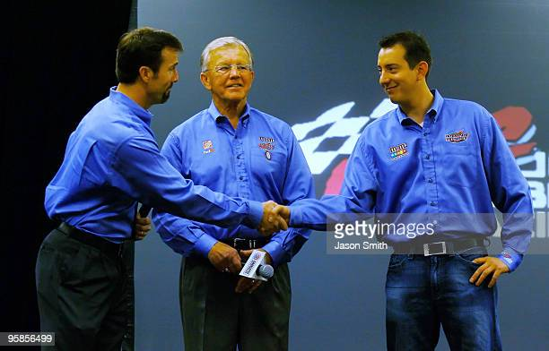 Joe Gibbs Racing team president JD Gibbs shakes hands with Kyle Busch driver of the MM's Toyota as team owner Joe Gibbs look on after speaking with...