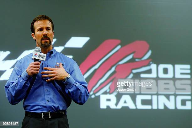 Joe Gibbs Racing team president JD Gibbs speaks with the media and fans during the NASCAR Sprint Media Tour hosted by Charlotte Motor Speedway on...
