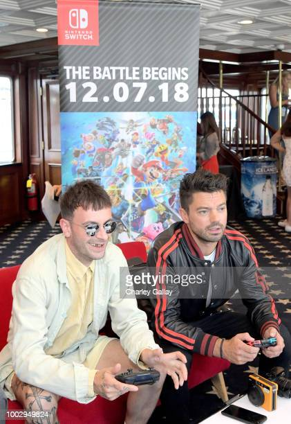 Joe Gilgun and Dominic Cooper test their skills on Super Smash Bros Ultimate for Nintendo Switch at the Variety Studio at ComicCon 2018 on July 20...