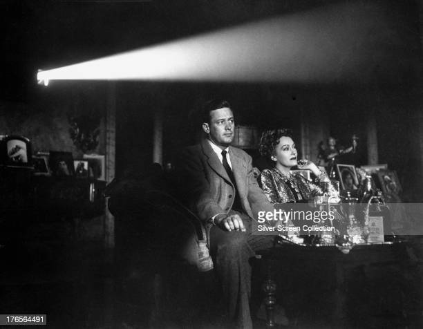 Joe Gillis played by William Holden and Norma Desmond played by Gloria Swanson watch the screening of a film in 'Sunset Boulevard' directed by Billy...
