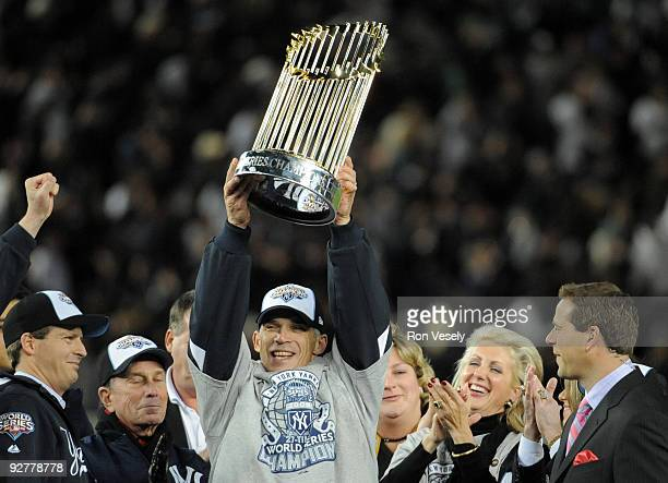Joe Girardi manager of the New York Yankees holds up the World Series trophy after their 73 win over the Philadelphia Phillies in Game Six of the...