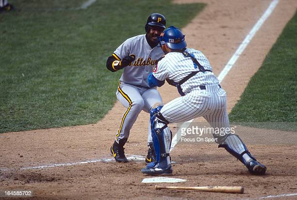 Joe Girardi of the Chicago Cubs tags out Barry Bonds of the Pittsburgh Pirates during an Major League Baseball game circa 1992 at Wrigley Field in...