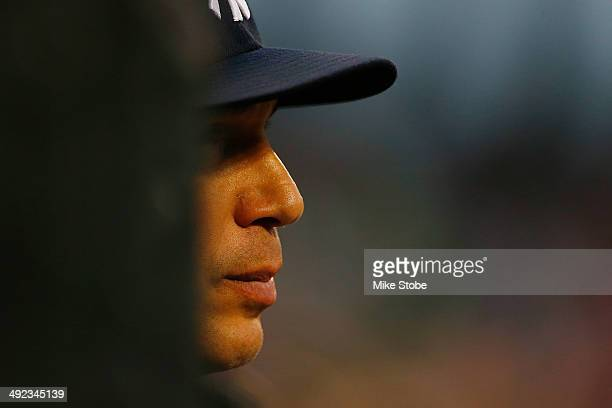Joe Girardi of the New York Yankees looks on from the dugout in the second inning against the New York Mets on May 15, 2014 at Citi Field in the...