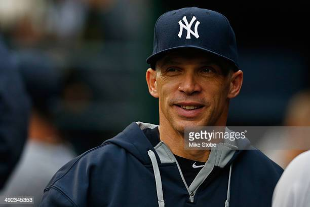 Joe Girardi of the New York Yankees looks on from the dugout prior to the game against the New York Mets on May 15, 2014 at Citi Field in the...