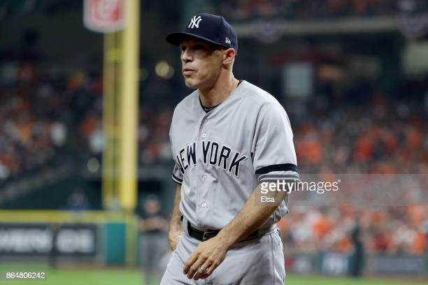 Joe Girardi of the New York Yankees walks back to the dugout against the Houston Astros during the second inning in Game Seven of the American League...