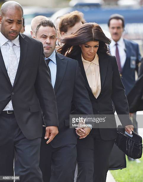 Joe Giudice and wife Teresa Giudice arrive for sentencing at federal court in Newark on October 2 2014 in Newark New Jersey