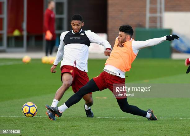 Joe Gomez and Alex OxladeChamberlain of Liverpool during the training session at Melwood Training Ground on March 15 2018 in Liverpool England
