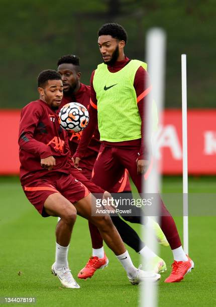 Joe Gomez and Elijah Dixon-Bonner of Liverpool during a training session at AXA Training Centre on September 30, 2021 in Kirkby, England.