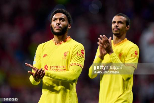 Joe Gomez and Joel Matip of Liverpool FC thanks the fans after the game during the UEFA Champions League group B match between Atletico Madrid and...