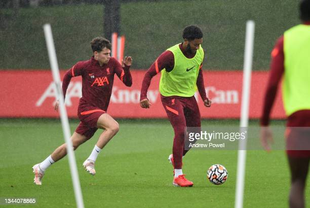 Joe Gomez and Neco Williams of Liverpool during a training session at AXA Training Centre on September 30, 2021 in Kirkby, England.