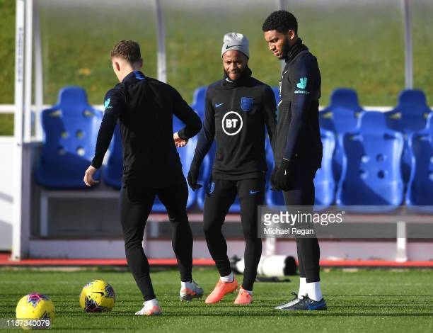Joe Gomez and Raheem Sterling train during and England Media Access Day at St Georges Park on November 13 2019 in BurtonuponTrent England